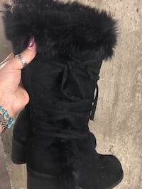 Boots size 5/6 + $5 for delivery to Burnaby or North van west van,