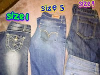 two blue and one gray denim jeans Louisville, 40272