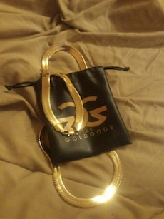 gold necklace with pouch