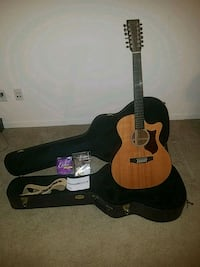 brown acoustic guitar with gig bag Zion, 60099