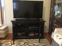 Like new. Beautiful Mahogany TV stand with glass doors.  Dimensions - 49 width 19 deep 29 height (TV not included) Arlington, 22204
