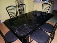 rectangular brown wooden table with four chairs dining set Toronto, M1B 1R3