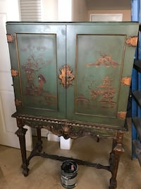 Green cabinet has a small cracked on the upper middle. Was stored so it needs a good cleaning Miami, 33142