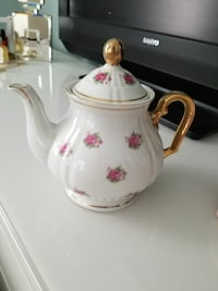 gold and white ceramic floral kettle