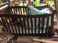 baby's brown wooden crib Columbia, 38401