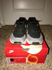Pair of black nike running shoes with box