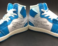 Pair of white-and-blue air jordan shoes New York, 10001