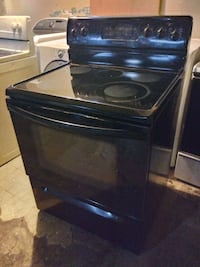 2015 black Kenmore glass top electric stove installed