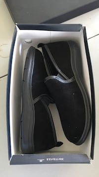 pair of black-and-gray slip-on shoes with box