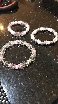 three pink plastic beaded bracelets Toronto, M9L 1C6