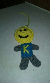 yellow,blue,and black crochet toy