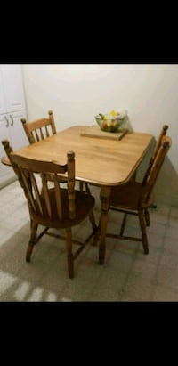 rectangular brown wooden table with four chairs i Courtice, L1E 1S4