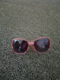 pink and black framed sunglasses null
