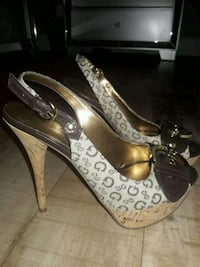 pair of brown leather open toe ankle strap heels Lake Worth, 33463