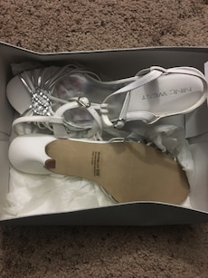 Women's pair of white Nine West peep toe t-strap heel shoes in the box