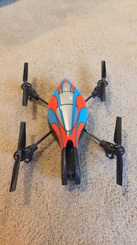 Two red and blue quadcopter drone