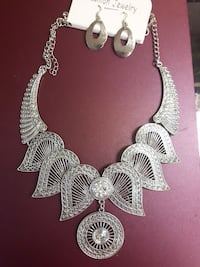 silver-colored bib necklace and earrings