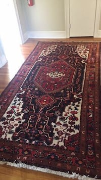 maroon and white tribal design area rug