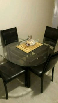new glass kitchen table with 4  mint condition leather chairs.nd gn nw Surrey, V3S 0Y7