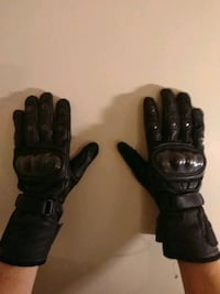pair of black leather gloves Portsmouth, 23707