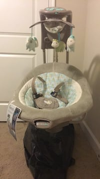 Baby's gray and white cradle and swing Gaithersburg, 20879