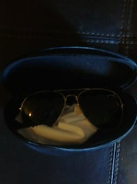 black framed sunglasses with case 589 km