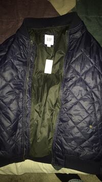 Men's medium gap jacket brand new wore it once. It is navy blue and still has the tag on it. East Ridge, 37353