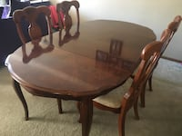 Oval brown wooden table with four chairs dining set Hopkins, 55343