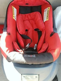 baby's red and gray car seat carrier