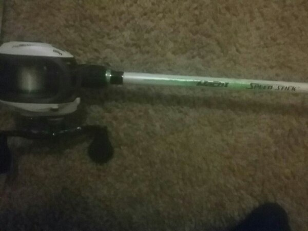 white and black fishing rod