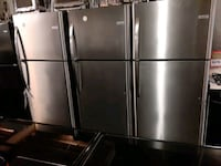 New scratch and dent top freezer refrigerator with warranty