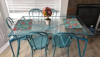 Glass table, chairs not included. Must get off my hands. Commerce City, 80603
