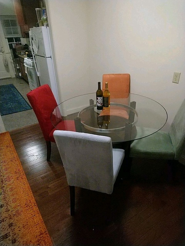 brown wooden base glass top table and chairs