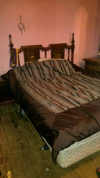 brown wooden bed frame with mattress Bainsville, K0C 1E0