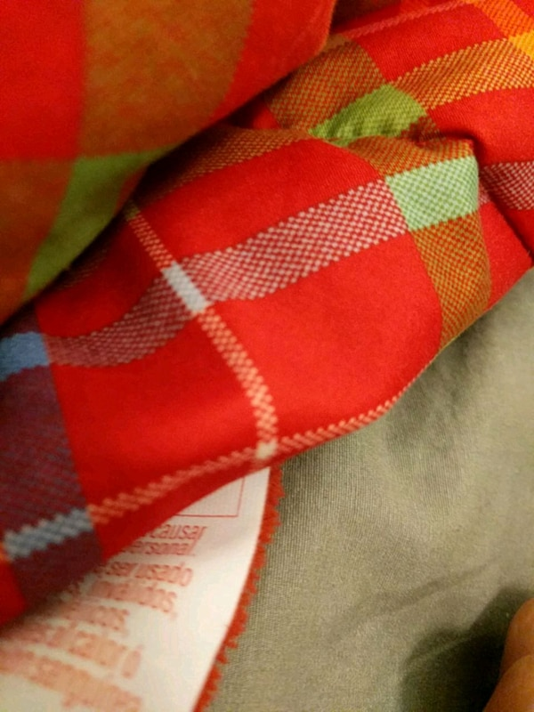 red, white, and black textile