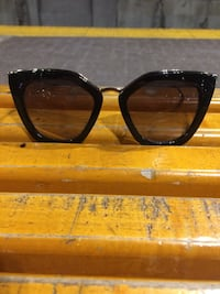 black framed sunglasses with brown lens Calgary, T2W 0H6