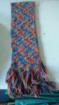 red, blue, and green crochet scarf
