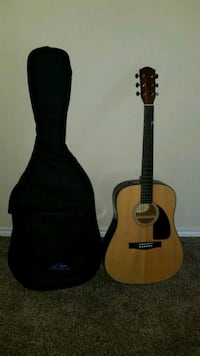 brown and black dreadnought acoustic guitar and black gig Webster, 77598