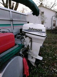 white and red Evinrude outboard motor Fayetteville, 37334