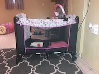 baby's black and pink travel cot Greenbelt