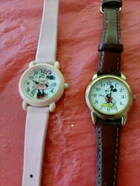 two round silver analog watches with black leather Redding