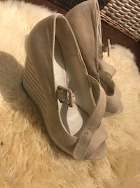 pair of gray suede peep-toe heeled shoes