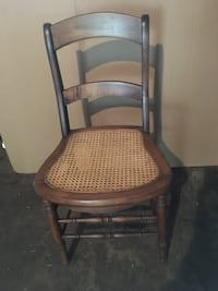 Wood side chair with cane seat in excellent condition . Kalamazoo, 49001