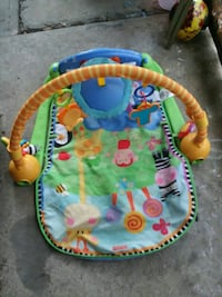baby's green and blue Fisher-Price activity gym