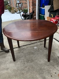 "Round brown wooden drop leaf table 42"" wide  42"" long  30"" tall   Shaler, 15116"