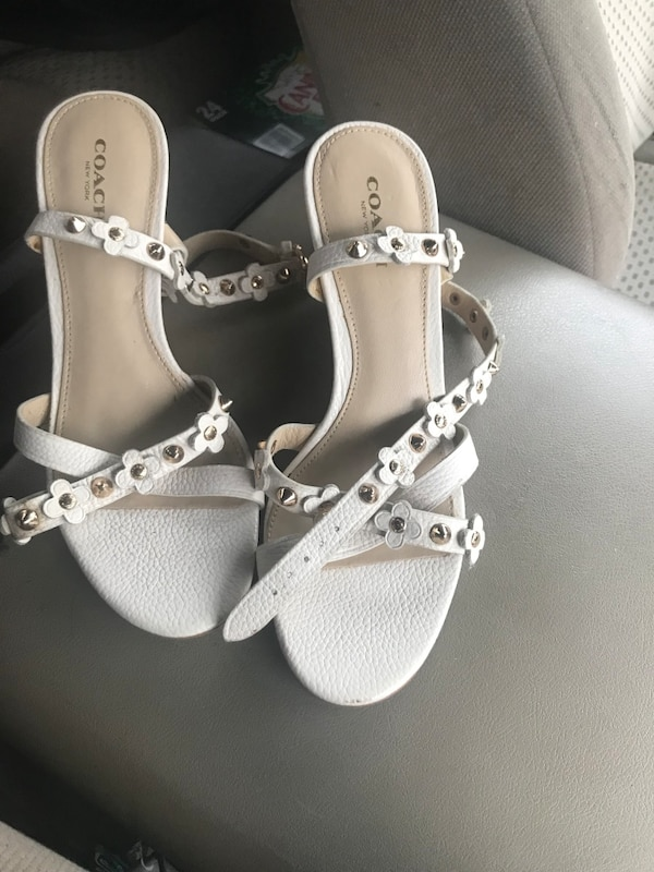 pair of white leather open toe ankle strap sandals