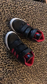 pair of black-and-red Nike sneakers Edmonton, T5X 0A6