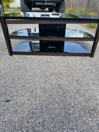 black metal framed glass TV stand