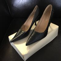 Black leather pointed-toe stilettos with box