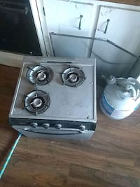 Propane operated cook stove comes complete and working order with tank